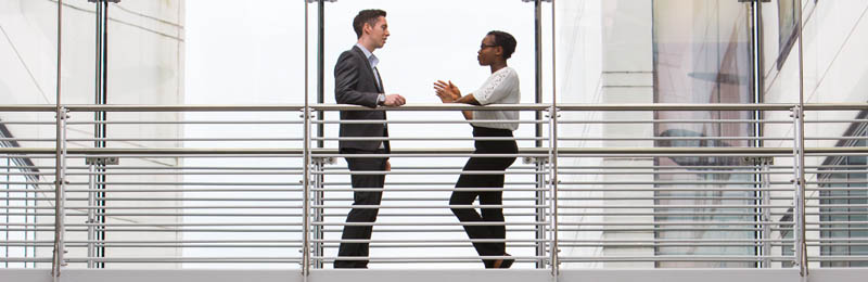 man and women talking in office building