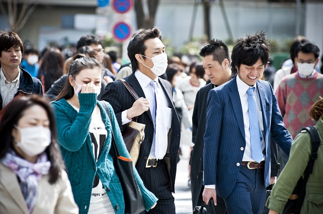 people wearing face masks to protect from pollution and viruses